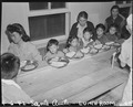 Arcadia, California. Meal time, cafeteria-style, for these children at Santa Anita assembly center . . . - NARA - 537029.tif
