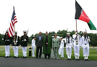 Foreign relations of Afghanistan - U.S. President George W. Bush with wife Laura Bush welcoming Afghan President Hamid Karzai at Camp David on 5 August 2007.