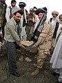 Arsala Jamal lays a dam's cornerstone.jpg