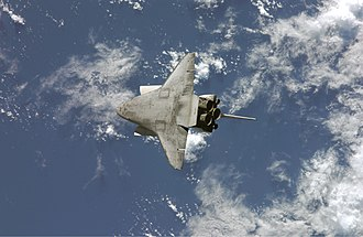 Rendezvous pitch maneuver - Underside view of Atlantis during STS-117, as it approached the International Space Station and performed a Rendezvous Pitch Maneuver.