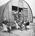 Australian pilots of No. 452 Squadron relax outside their dispersal hut at Kirton-in-Lindsey, 18 June 1941. CH2883.jpg