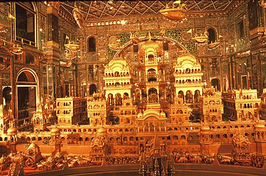Gold carving depiction of the legendary Ayodhya at the Ajmer Jain temple. Ayodhya Nagri.jpg