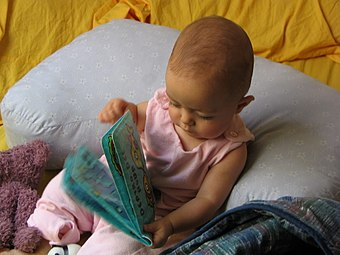 Developmental psychologists would engage a child with a book and then make observations based on how the child interacts with the object. Baby with book.jpg