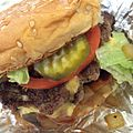 """Bacon cheeseburger """"all the way."""" In my book, distant fourth to In-N-Out, The Habit, and Smashburger. However, fries are excellent and the only reason to come back. (14516208939).jpg"""