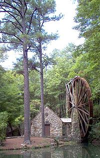 An overshot water wheel standing 42 feet high powers the Old Mill at Berry College in Rome, Georgia