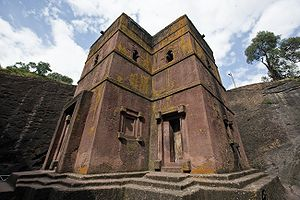 Rock-cut architecture - One of the 13 rock-hewn churches at Lalibela, Ethiopia, entirely cut out of the rock surface.