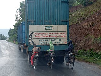 Kirundi - The Kirundi text on the back of the truck warns cyclists not to hold on to it.