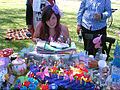 Blowin Out the Candles at birthday tea party picnic.jpg