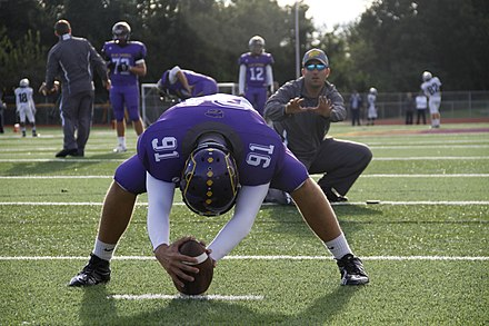 A long snapper practicing field goal snaps with his position coach Blue Springs High School long snapper selected for 2015 Semper Fidelis All-American Bowl 140912-M-XR064-026.jpg