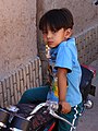 Boy on Bike - Yazd - Central Iran (7429221308) (2).jpg