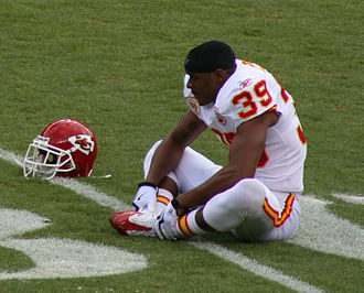 Brandon Carr - Carr stretching before a game in Denver in January, 2010.