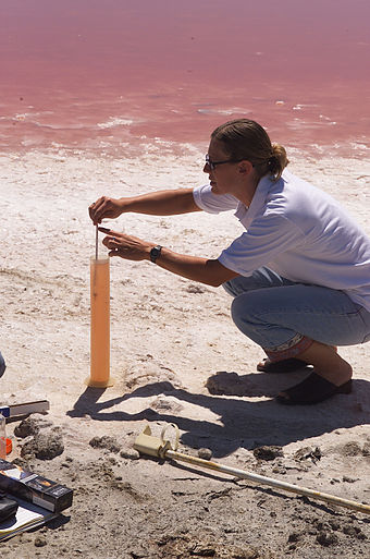 A NASA personnel using a hydrometer to measure the brine density of a salt evaporation pond. - Hydrometer