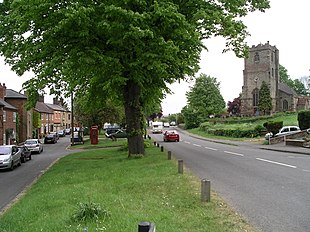 The church and main road in Brinklow