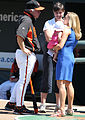 Buck Showalter and Amber Theoharis with her baby Dylan Mattea.jpg