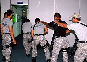 Special Task And Rescue - STAR personnel prepare to enter a room during Cooperation Afloat Readiness and Training (CARAT) Malaysia 2011