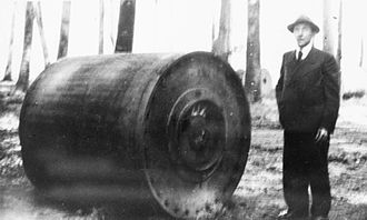 Bouncing bomb - A German official with the bomb recovered from the wreckage of Flt Lt Barlow's Lancaster