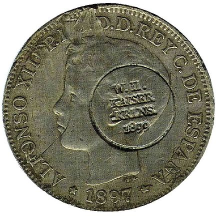 Spanish currency used in the Caroline Islands at the end of the 19th century. Note the German circular punch, made following the Spanish cession of the islands to Germany in 1899. Carolinas Islands coin 2013 derivate 000.jpg