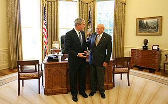 S. Truett Cathy - President George W. Bush stands with Truett Cathy after he received the Lifetime President's Volunteer Service Award at the White House