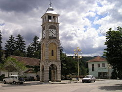 The central square in Chuprene with the clock tower, the church and the school