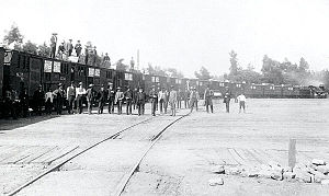 "History of rail transportation in California - A special ""fast fruit"" train of the Central Pacific Railroad prepares to head eastward on June 24, 1886."