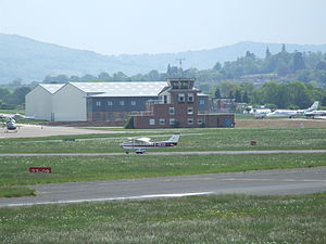 Gloucestershire Airport - A Cessna 172 G-BEZO belonging to the Staverton Flying School seen taxiing in after landing. The control tower and part of the main apron are visible in the background.