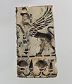 Champlevé furniture or cosmetic box plaque with a griffin and a floral frieze MET DP110667.jpg