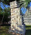 Chichén Itzá. The Ossuary. Stone masks of the Southeast corner - panoramio.jpg