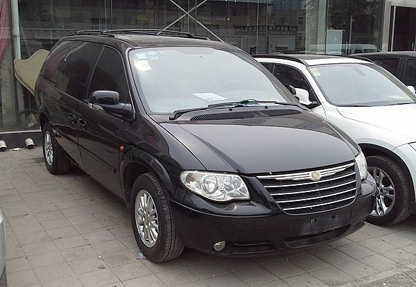 A Soueast Chrysler-made Chrysler Grand Voyager RS van in a used car market in Beijing in 2014. Chrysler Grand Voyager RS facelift 2 China 2014-04-25.jpg