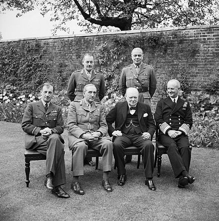Winston Churchill with the Chiefs of Staff, including Ismay (standing on the right)