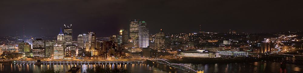 a panorama of downtown Pittsburgh taken from Mount Washington at night.