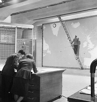 Coastal Command (film) - Sergeant Holland (NCOIC Ops Room Clerk) discusses a point with Plotter Assistant Section Officer Bewkey.