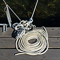 Coiled white rope on a jetty.jpg