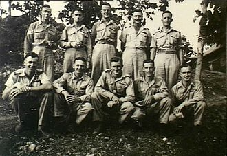 Colin McCool - McCool with fellow members of the No. 33 Squadron at Laloki River, New Guinea circa 1943. McCool is in the front row, centre.