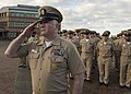 Command Master Chief Josh Dugan renders a salute for a formation of chief petty officers. (16835051888).jpg