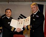 Commander Haigh and his opposite number Commander Ha, Sung Wook exchange gifts. Image by LA(Phot) Keith Morgan.jpg