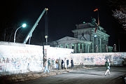 A crane removing a section of the Berlin Wall near Brandenburg Gate on December 21, 1989
