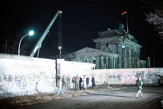 Brandenburg Gate - A crane removes a section of the Berlin Wall near Brandenburg Gate on 21 December 1989.