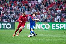 Ronaldo evades club teammate Luka Modrić during a friendly match against  Croatia in June 2013