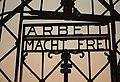 Dachau Concentration Camp Gate, replica sign ARBEIT MACHT FREI (9813240585).jpg
