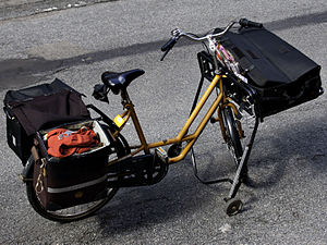 Cycling in Denmark - Postal bike used in a city by Post Danmark