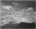 "Dark foreground and clouds, mountains highlighted, ""Heaven's Peak,"" Glacier National Park, Montana., 1933 - 1942 - NARA - 519871.tif"
