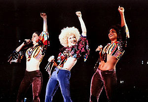 "The Girlie Show World Tour - Madonna and her back up singers and dancers Donna De Lory and Niki Haris wore disco-inspired clothing for the performance of ""Deeper and Deeper""."