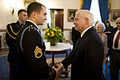 Defense.gov News Photo 101115-A-0193C-015 - U.S. Army Staff Sgt. Salvatore Giunta left talks with Secretary of Defense Robert M. Gates prior to the Medal of Honor presentation ceremony at the.jpg