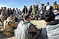 Defense.gov News Photo 101219-F-2185F-178 - U.S. Air Force Capt. Ryan Weld center and Romanian Forces from Task Force Black Scorpion talk with villagers during a shura in Khleqdad Khan.jpg
