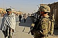 Defense.gov News Photo 111207-F-FT240-039 - U.S. Army Spc. Jason Bruno secures an area during an assessment of the local bazaar in the Shah Joy district of Zabul province Afghanistan on.jpg
