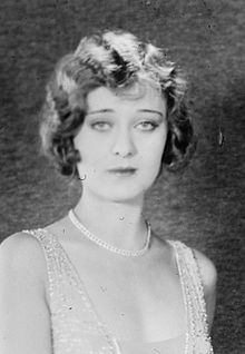 Portrait bust of a young Dolores Costello, facing the camera, looking stylish and slightly unhappy or bored