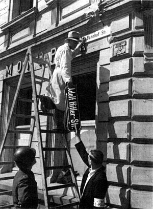 "Denazification - Workers removing the signage from a former ""Adolf Hitler Street"" in Trier, May 1945"
