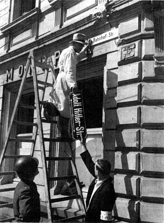 "Denazification - Workers removing the signage from a former ""Adolf Hitler Strasse"" (street) in Trier, May 1945"