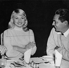 Diane Cilento lunching with Peter Finch at Pinewoods Studio (7947286770).jpg