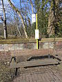 Disused bus stop and bench on Hillbark Road, Frankby.JPG